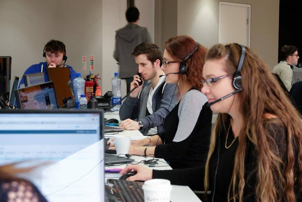 People working in customer service department