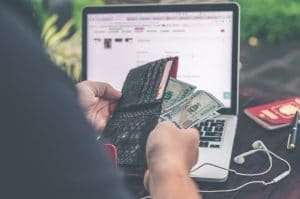 hacker getting money from laptop