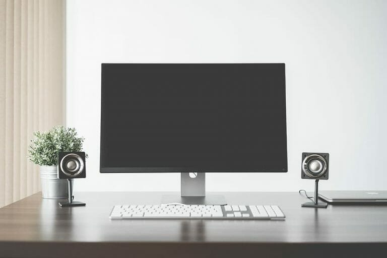 monitor and speakers on the desk