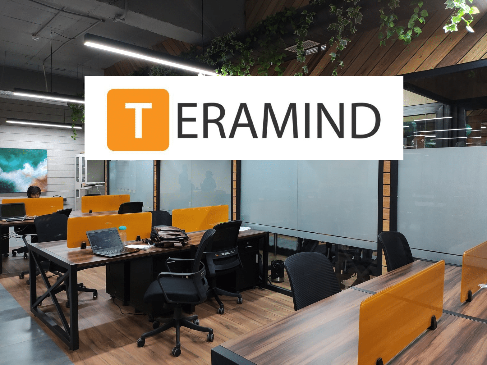 An office and Teramind logo