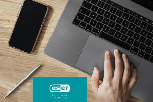 ESET logo, laptop keyboard and cell phone