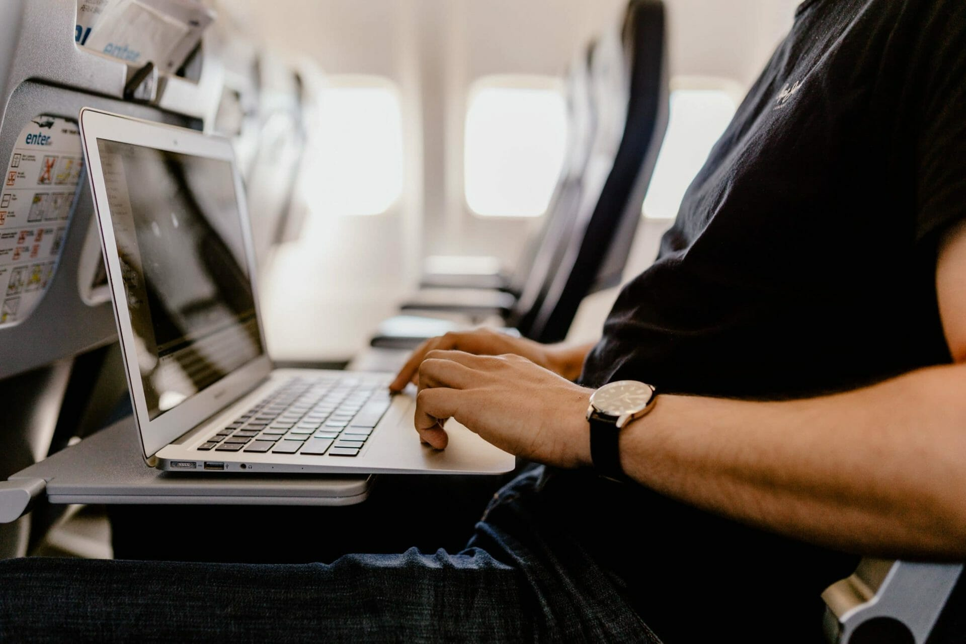 a person typing on laptop