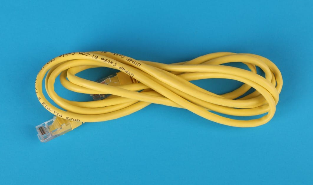 blue table and yellow cable