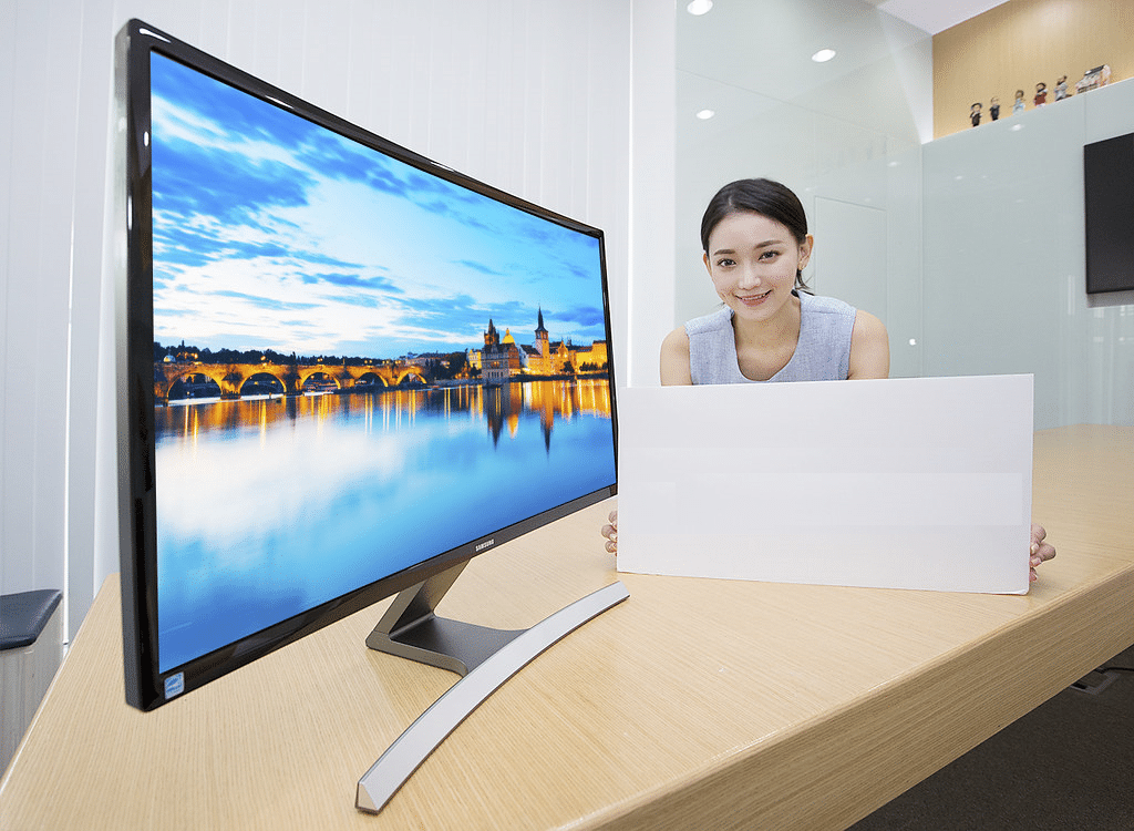 girl by the large monitor
