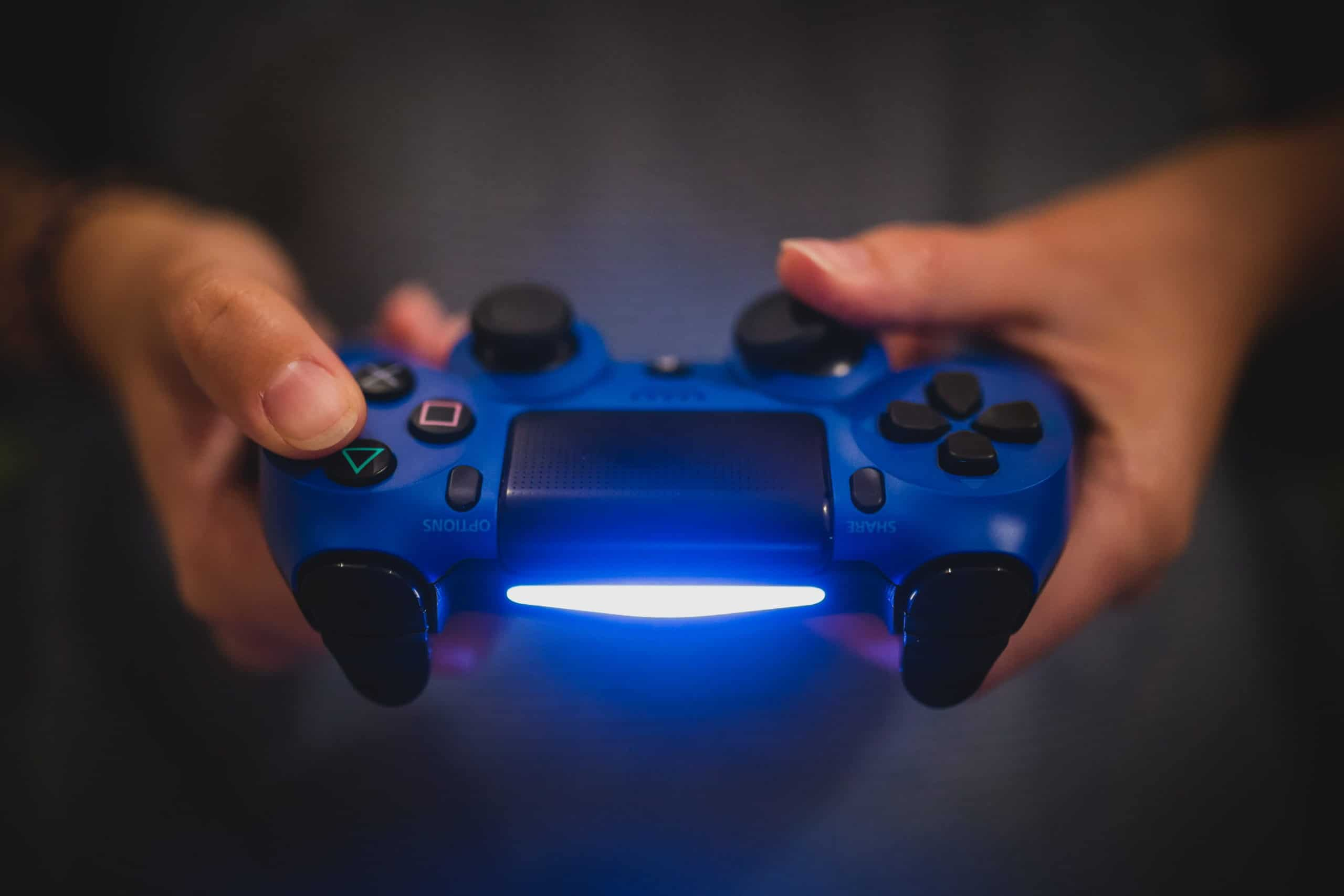 blue gaming controller in hands