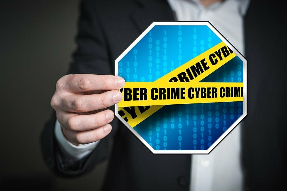 a person holding a Cyber Crime sign