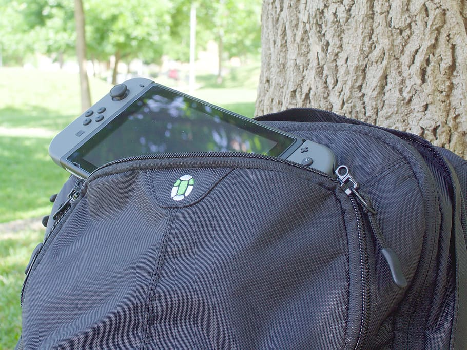 Nintendo in the pocket of the black backpack