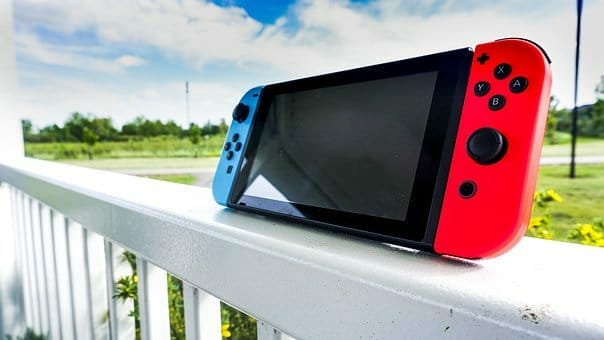Nintendo Switch on the white fence