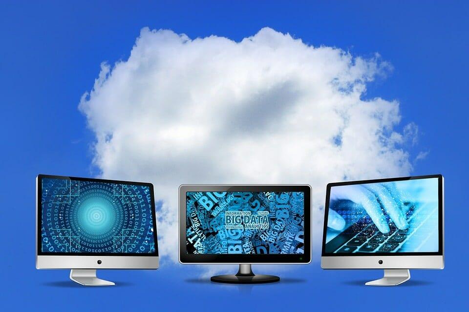 three monitors and a cloud
