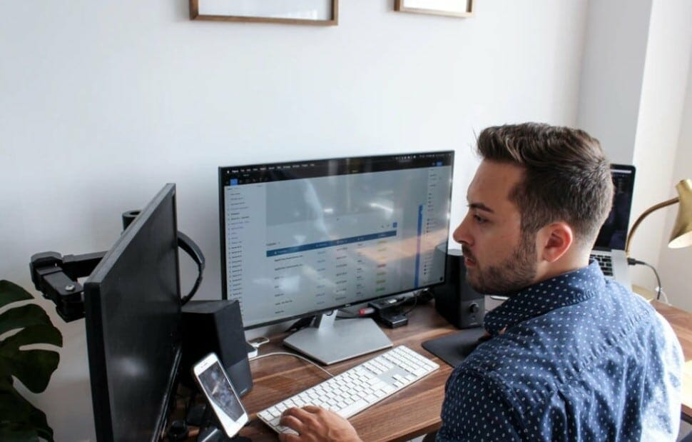 man with two screens