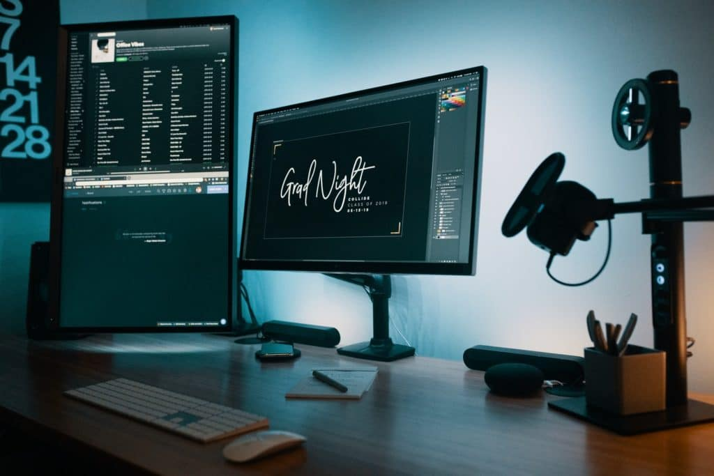 two monitor on the working desk