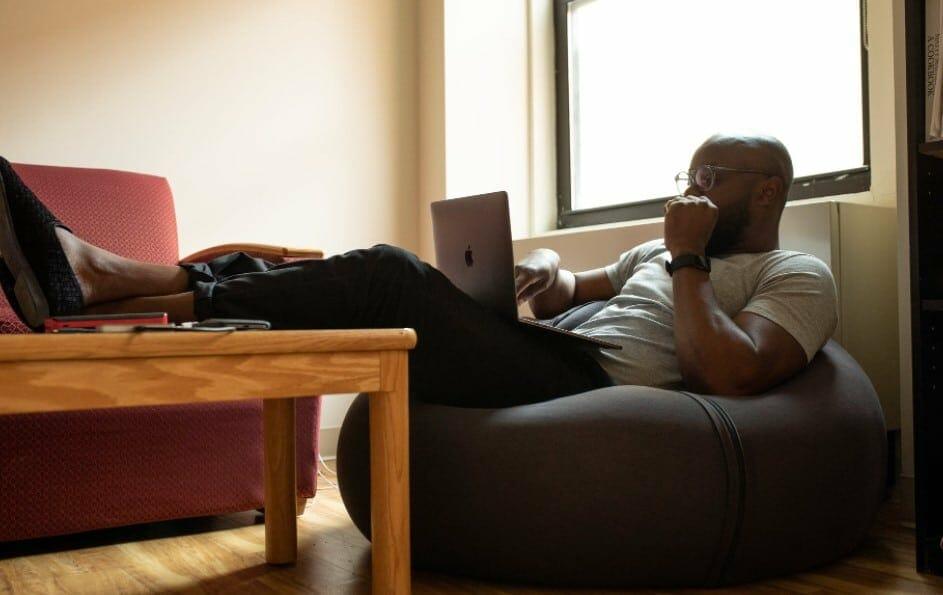 bald man on laptop